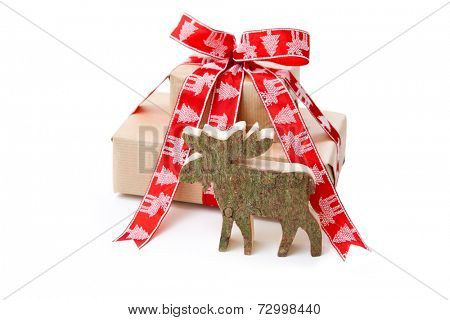 Christmas presents with red bow and wooden moose on white background