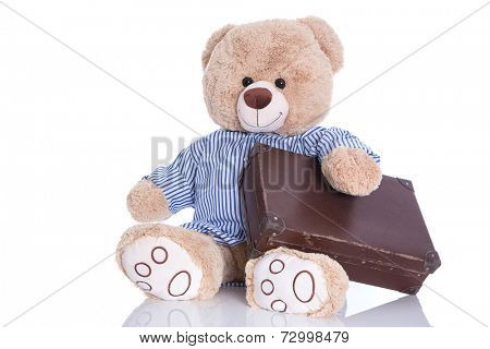 Teddy bear with suitcase isolated on white background - sabbatical or holiday concept