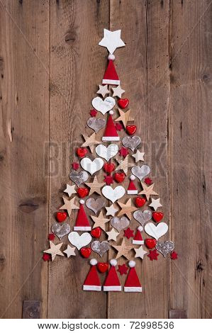 New design for a christmas tree - red and white decoration for xmas on a wooden brown background
