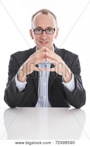 Pleased businessman sitting at desk fingers touching isolated on white background