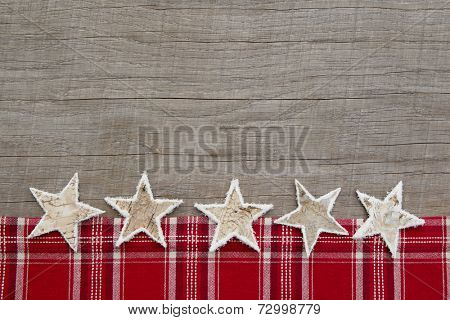 Rustic wooden shabby chic background with a checkered frame for christmas - or a advertising board for publicity or a greeting card