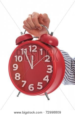Symbol of time : hand holding red clock , eleventh hour isolated on white background