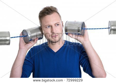 Stressed man overworked holding tin can phones isolated on white background