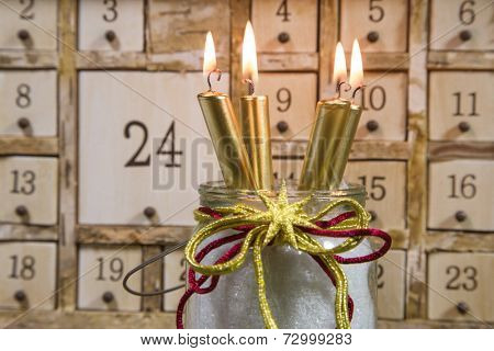 Shabby chic advents calendar with four gold burning candles