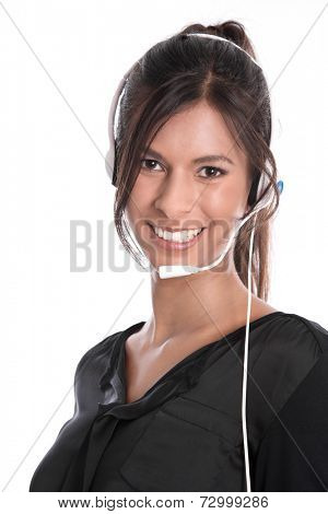 Pretty woman with headset facing camera isolated on white background