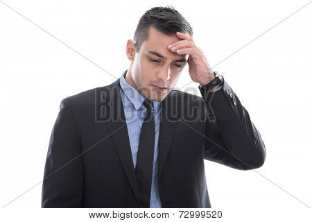 Migraine: young businessman with headache in business suit isolated on white background