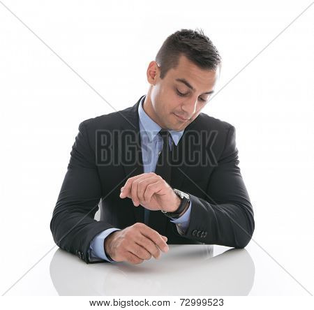 Time: attractive businessman looking at his watch isolated on white background