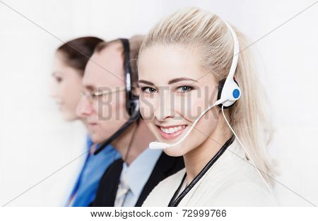 Telesales or helpdesk team - helpful woman with headset smling at camera
