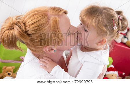 Unconditional love - a Kiss - mother and daughter