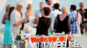 foto of buffet  - Red cocktails in glasses and cold champagne ready for party people.