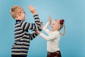 pic of encounter  - Brother and sister start a playful fight with each other - JPG