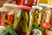 stock photo of pickled vegetables  - Composition with jars of pickled vegetables - JPG