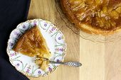picture of tarts  - Caramelised apple tarte tart tartin fancy cake pie on glass plate slice cut off on saple table with serving plate - JPG