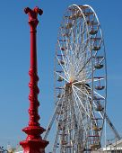 picture of lamp post  - Red Victorian lamp post and ferris wheel - JPG