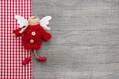 foto of guardian  - Red guardian or christmas angel in country style for a greeting card or gift card - JPG