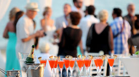 stock photo of buffet catering  - Red cocktails in glasses and cold champagne ready for party people.