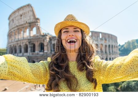 Young Woman Making Selfie In Front Of Colosseum In Rome, Italy