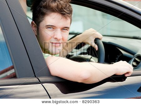 Happy Young Male Driver Sitting In His Car