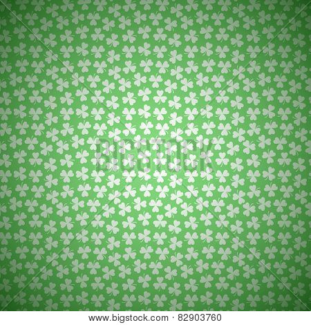 Green Floral Background with White Seamless Pattern from Shamrocks for Happy Saint Patricks Day