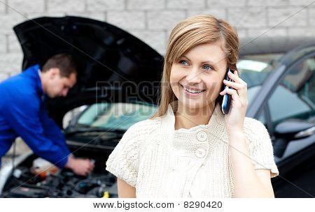 Man Repairing Car Of Busy Woman