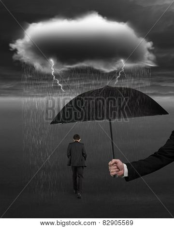 Hand Holding Umbrella Protecting Businessman From Dark Cloud Rain Lightning