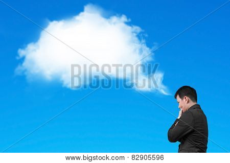 Businessman Thinking About White Cloud Thought Bubble Isolated On Blue