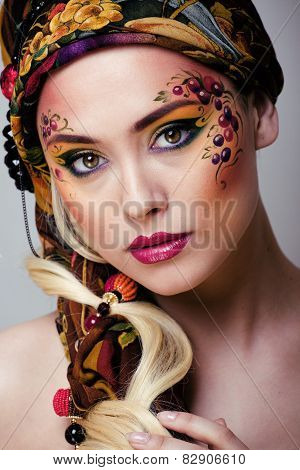 portrait of contemporary noblewoman with face art creative close
