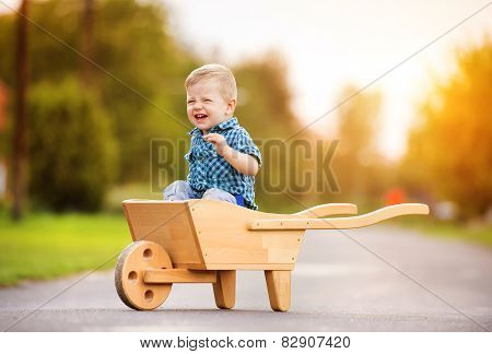 Little boy playing outside