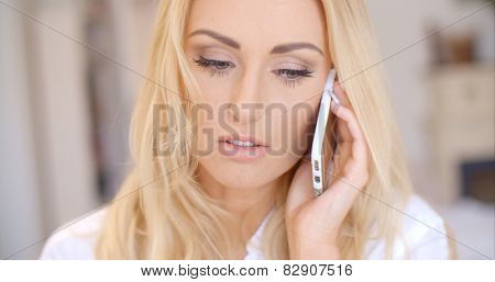 Close up Attractive Young Blond Woman Calling Someone Through her Mobile Phone