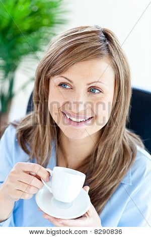 Happy Businesswoman Holding A Cup Siiting
