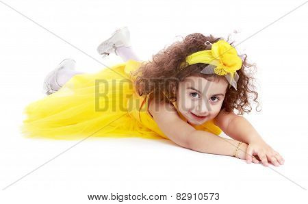 Stylish little girl in a yellow dress