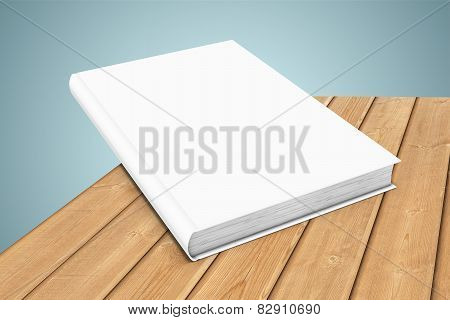 White blank book on wooden planks