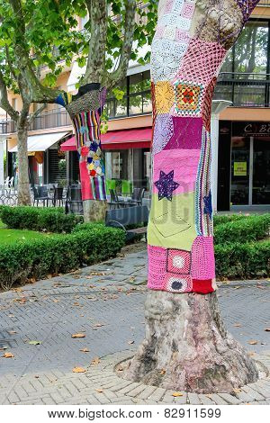 Knitted Clothes On Trees Decorate Street In The Resort Town Bellaria Igea Marina, Rimini, Italy