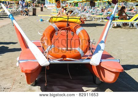 Safety Equipment On The Beach. Lifebuoy And A Belt On Catamaran In The Resort Town Bellaria Igea Mar