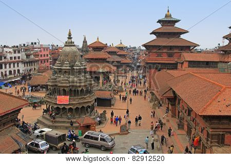 PATAN, NEPAL - APRIL 2014 : Tourists and local people visiting Patan Durbar Square in Patan, Nepal on 13 April 2014