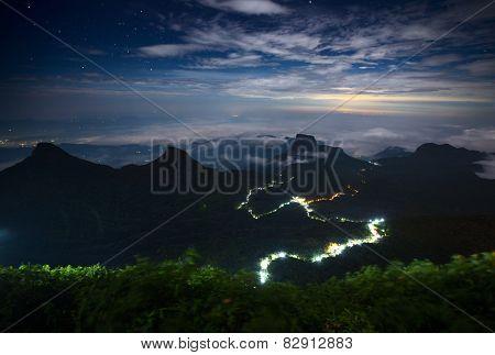 Illuminated walkway from the city of Ratnapura to the top of the mountain Adam's peak. Sri Lanka