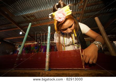 A Kayan Lahwi Girl Is Spinning.