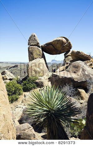 Tourist Sitting Under Balanced Rock