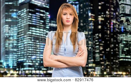 Young woman portrait against nighttime city