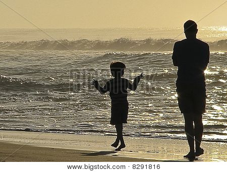 Father And Son Take A Walk At Sunrise