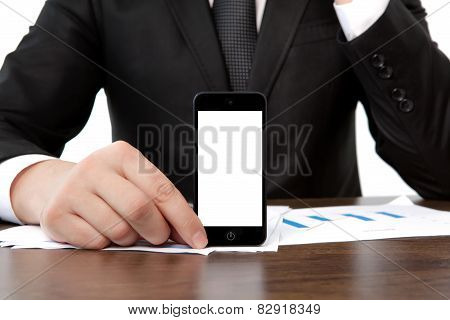 Businessman At The Office Holding A Touch Phone With Isolated Screen