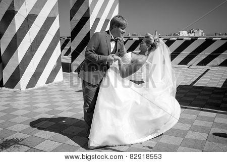 Monochrome Photo Of Bride And Groom Dancing On Roof Top