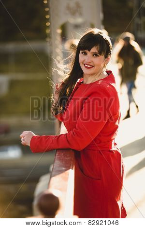 Brunette Woman Posing On Bridge At Cold Windy Day