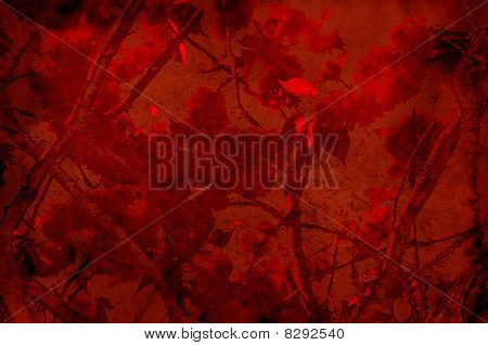 Textured red background with foliage and branches - scrapbooking