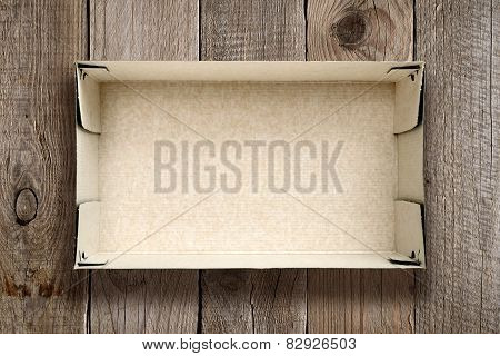 Empty Cardboard Box On Wooden Background