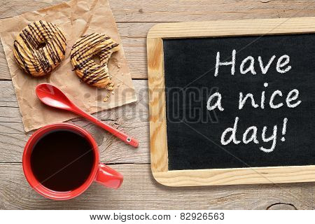Coffee Cup, Cookies And Chalkboard With Phrase Have A Nice Day!