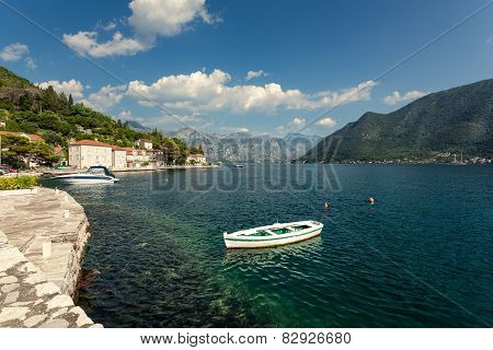Wooden Rowboat Mooring At Bay Of Kotor In Perast City At Sunny Day
