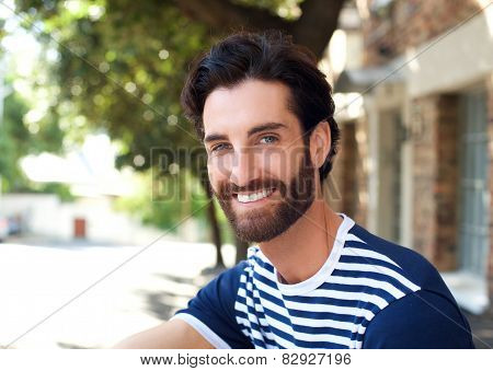 Smiling Young Man With Beard