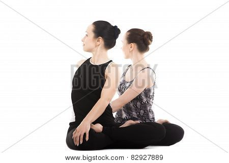 Two Yogi Female Partners Sitting In Yoga Lotus Pose