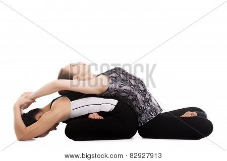 Yogi Girls Doing Yoga Exercises In Lotus Pose